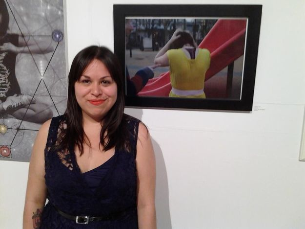 "Cathleen showing her work from a past project ""The Childhood Project"" at an exhibit in Jersey City"